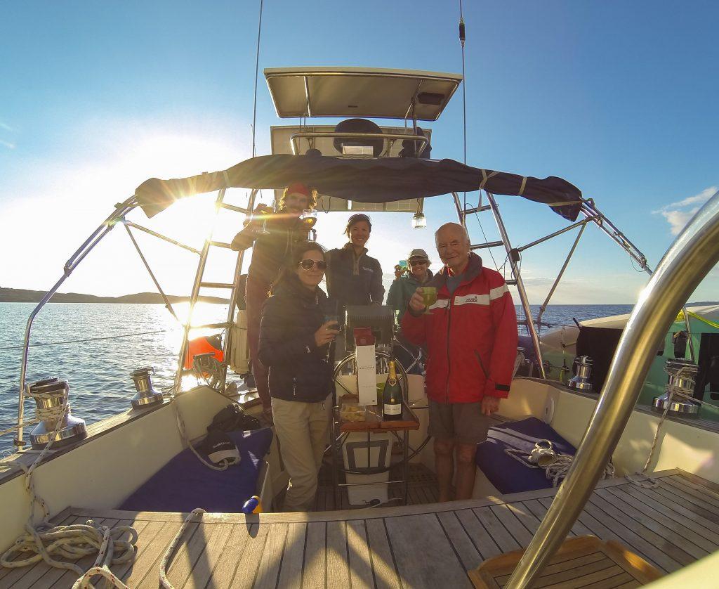 Left to Right: Tim, Ginny, Kara, Julie, John - raising a glass to love, life, friendship, and sailing!
